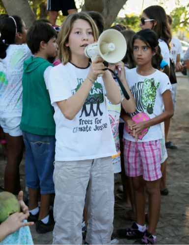 Girl with Microphone giving speech about Climate justice